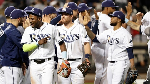 Tampa Bay Rays' Adeiny Hechavarria, left, celebrates with teammates after a baseball game against the New York Yankees on Tuesday, Sept. 12, 2017, in New York. The Rays won 2-1. (AP Photo/Frank Franklin II)