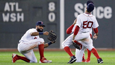 Boston Red Sox right fielder Mookie Betts (50) celebrates with teammates after defeating the Oakland Athletics 11-1 in a baseball game at Fenway Park in Boston, Tuesday, Sept. 12, 2017. Betts had six RBI's in the game. (AP Photo/Charles Krupa)