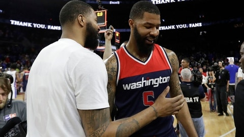 Detroit Pistons forward Marcus Morris, left, greets his brotherWashington Wizards forward Markieff Morris after an NBA basketball game, Monday, April 10, 2017, in Auburn Hills, Mich. (AP Photo/Carlos Osorio)