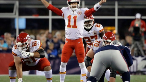 FILE - In this Thursday, Sept. 7, 2017, file photo, Kansas City Chiefs quarterback Alex Smith (11) calls signals at the line of scrimmage during the first half of an NFL football game against the New England Patriots, in Foxborough, Mass. Alex Smith outplayed the Patriots' Tom Brady in their season opener last week, serving notice that he isn't going anywhere as Kansas City's starter.(AP Photo/Steven Senne, File)