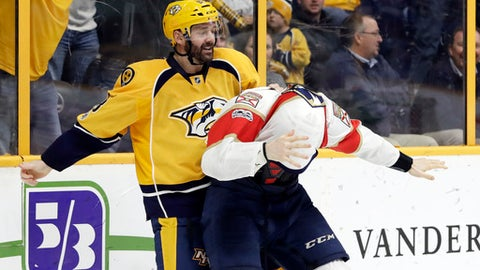 Nashville Predators center Vernon Fiddler (83) pulls the jersey of Florida Panthers center Michael Sgarbossa over his head as they fight during the second period of an NHL hockey game Saturday, Feb. 11, 2017, in Nashville, Tenn. (AP Photo/Mark Humphrey)