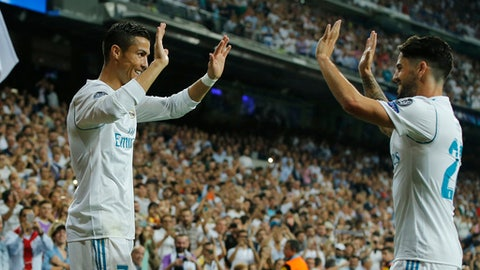 Real Madrid's Cristiano Ronaldo, left, celebrates scoring with teammate Isco during a Champions League group H soccer match between Real Madrid and Apoel Nicosia at the Santiago Bernabeu stadium in Madrid, Spain, Wednesday, Sept. 13, 2017. (AP Photo/Paul White)