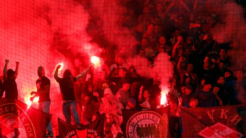 Spartak supporters light a flare during the Champions League soccer match between Maribor and Spartak Moskva at the Ljudski vrt stadium, in Maribor, Slovenia, Wednesday, Sept. 13, 2017. (AP Photo/Darko Bandic)
