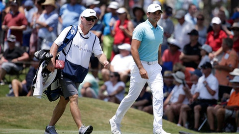 FILE - In this March 11, 2017, file photo, Jason Day, of Australia, right, walks with his caddie, Colin Swatton, on the eighth hole during the first round at The Players Championship golf tournament, in Ponte Vedra Beach, Fla. Day said he is temporary parting with Swatton, who has been his coach and caddie his entire career. (AP Photo/Lynne Sladky, File)