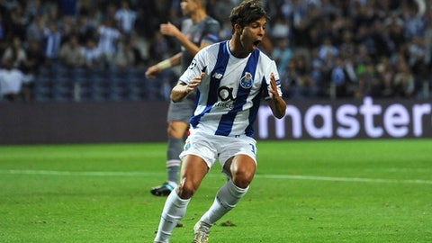 Porto's Oliver Torres reacts after missing a chance to score during the Champions League group G soccer match between FC Porto and Besiktas at the Dragao stadium in Porto, Portugal, Wednesday, Sept. 13, 2017. (AP Photo/Paulo Duarte)