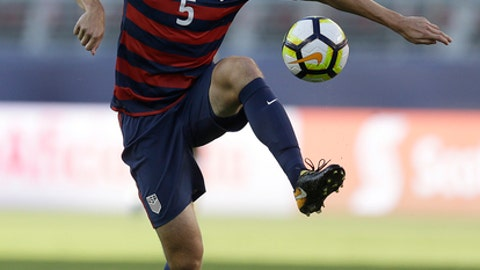 "FILE - In this  July 26, 2017, file photo, United States' Matt Besler controls the ball during the first half of the Gold Cup final soccer match against Jamaica, in Santa Clara, Calif. Besler got a concussion and became an author. The U.S. national team regular began journaling last year as part of his recovery. The result was his book, ""No Other Home: Living, Leading, and Learning What Matters Most."" The book's release on Nov. 7 comes at a particularly busy time for Besler, who is in the midst of World Cup qualifying with the national team, and the playoff push for Sporting Kansas City. (AP Photo/Ben Margot, File)"