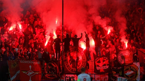Spartak supporters light a flare during the Champions League soccer match between Maribor and Spartak Moscow at the Ljudski vrt stadium, in Maribor, Slovenia, Wednesday, Sept. 13, 2017. (AP Photo/Darko Bandic)