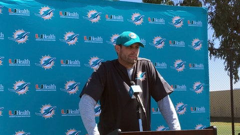 Miami Dolphins coach Adam Gase speaks with reporters before practice in Oxnard, Calif., on Wednesday, Sept. 13, 2017. The Dolphins are spending the week practicing on the California coast after leaving Miami several days early to avoid Hurricane Irma. The Dolphins open their NFL football season Sunday against the Los Angeles Chargers. (AP Photo/Greg Beacham)