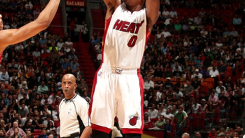 MIAMI, FL - APRIL 12: Josh Richardson #0 of the Miami Heat shoots the ball during the game against the Washington Wizards on April 12, 2017 at AmericanAirlines Arena in Miami, Florida. NOTE TO USER: User expressly acknowledges and agrees that, by downloading and or using this Photograph, user is consenting to the terms and conditions of the Getty Images License Agreement. Mandatory Copyright Notice: Copyright 2017 NBAE (Photo by Issac Baldizon/NBAE via Getty Images)