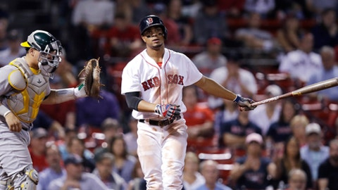 Boston Red Sox's Xander Bogaerts, right, strikes out swinging to end a baseball game against the Oakland Athletics at Fenway Park in Boston, Wednesday, Sept. 13, 2017. At left is Athletics catcher Bruce Maxwell. The A's won 7-3. (AP Photo/Charles Krupa)