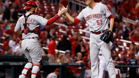 Cincinnati Reds starting pitcher Luke Farrell, right, and catcher Tucker Barnhart celebrate following a 6-0 victory over the St. Louis Cardinals in a baseball game Wednesday, Sept. 13, 2017, in St. Louis. (AP Photo/Jeff Roberson)