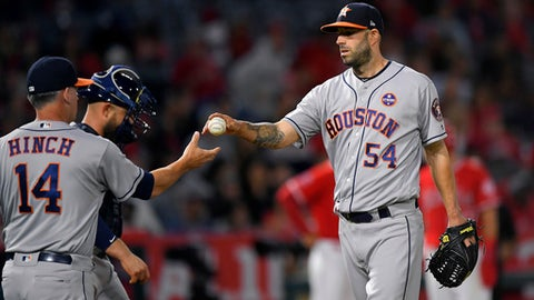 Houston Astros starting pitcher Mike Fiers, right, is taken out of the game by manager A.J. Hinch, left, as catcher Max Stassi stands next to Hinch during the fourth inning of a baseball game against the Los Angeles Angels, Wednesday, Sept. 13, 2017, in Anaheim, Calif. (AP Photo/Mark J. Terrill)