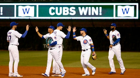The Chicago Cubs celebrate the team's 17-5 win over the New York Mets in a baseball game Wednesday, Sept. 13, 2017, in Chicago. (AP Photo/Charles Rex Arbogast)