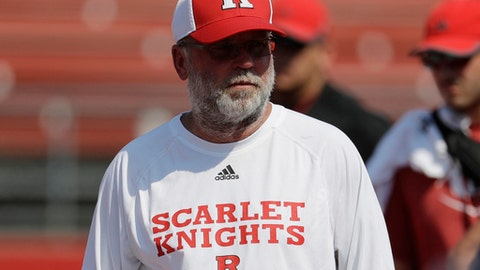 """FILE - In this Aug. 4, 2017, file photo, Rutgers offensive coordinator Jerry Kill watches drills during college football practice in Piscataway, N.J.  Jerry Kill will be on the sideline Saturday, Sept. 16, 2017, when the Scarlet Knights (0-2) face Morgan State (0-2). Kill was hospitalized Sunday after having a seizure, but coach Chris Ash says the 56-year-old is fine. """"We're moving forward,"""" Ash said.(AP Photo/Julio Cortez, File)"""
