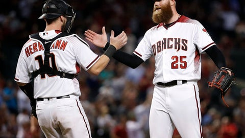 Pollock, Martinez lead Godley, Diamondbacks over Rockies 7-0