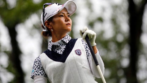 Ai Miyazato of Japan follows her ball after playing on the 10th hole during the first round of the Evian Championship women's golf tournament in Evian, eastern France, Thursday, Sept. 14, 2017. (AP Photo/Laurent Cipriani)