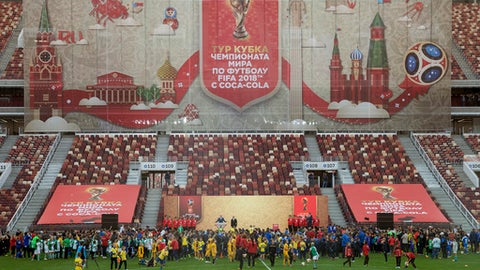 FILE- In this Saturday, Sept. 9, 2017 file photo, Russian President Vladimir Putin and FIFA President Gianni Infantino present the FIFA World Cup trophy at Moscow's Luzhniki Stadium, Russia. Ticket sales have started for next year's soccer World Cup in Russia, with prices ranging from 1,280 rubles ($22) for the cheapest tickets _ a price available to Russian fans only _ to 66,000 rubles ($1,100) for top-level seats at the final. (AP Photo/Ivan Sekretarev, File)