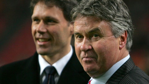 In this Wednesday Feb. 7, 2007, file photo Russia's coach Guus Hiddink of Netherlands, right, and Netherlands' coach Marco van Basten, left, wait for the start of their friendly international soccer match in ArenA stadium in Amsterdam. Guus Hiddink says he is willing to become a technical advisor to South Korea's football team at the World Cup next year, but has dismissed rumors that he will again be appointed coach of the team during a press conference in Amsterdam Thursday Sept. 14, 2017. Hiddink has been revered in South Korea ever since he led the team to the semifinals of the World Cup in 2002 when Korea and Japan co-hosted the tournament. (AP Photo/Peter Dejong)