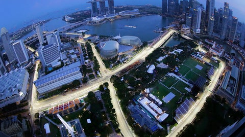 In this image made with a fisheye lens from the Swissotel The Stamford, the Singapore F1 Grand Prix's Marina Bay City Circuit is lit at dusk in Singapore, Thursday, Sept. 14, 2017. The Singapore Formula One Grand Prix which will be held on Sunday, Sept. 17, 2017. (AP Photo/Wong Maye-E)