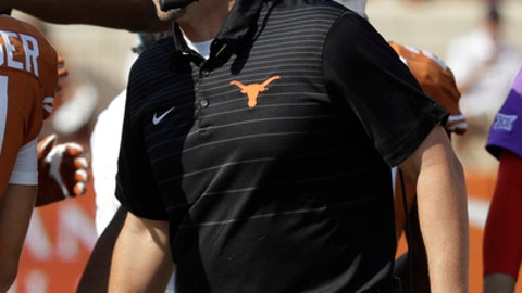 FILE - In this Sept. 9, 2017, file photo, Texas head coach Tom Herman talks with players on the sideline during an NCAA college football game against San Jose State, in Austin, Texas. Herman took over a Texas program with plenty of ups and downs since being the league's last national champ 12 seasons ago, Matt Rhule never expected his job at Baylor to be easy, and Lincoln Riley suddenly was leading the 10-time league champ with a Heisman Trophy-caliber quarterback. The results so far clearly reflect the situations inherited by the Big 12's three new head coaches. (AP Photo/Eric Gay, File)