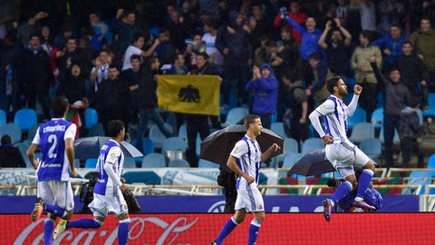 FILE - In this Nov.5, 2016 file photo, Real Sociedad's Willian Jose, right, jumps as he celebrates his goal during the Spanish La Liga soccer match between Atletico de Madrid and Real Sociedad, at Anoeta stadium, in San Sebastian, northern Spain. The last time Real Sociedad had such a good start in the Spanish league, it went on to win the title. A home victory on Sunday Sept. 17, 2017 will extend Real Sociedad's perfect record and keep it at the top of the league standings. (AP Photo/Alvaro Barrientos, File)