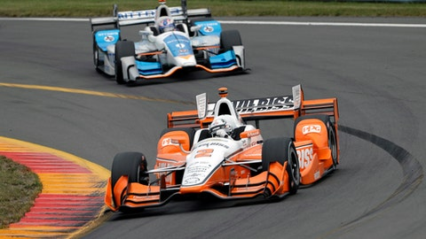 FILE - In this Sept. 3, 2017, file photo, Josef Newgarden (2) leads Scott Dixon (9) through Turn 11 during an IndyCar Series auto race, in Watkins Glen, N.Y. As NASCAR prepares to open its playoffs, the IndyCar Series is ready to crown its champion. Four drivers go into the season finale Sunday at Sonoma Raceway in contention for the title, which is a Penske vs. Ganassi showdown. Josef Newgarden holds a three-point lead in the standings over Ganassi driver Scott Dixon. Newgarden's two Penske teammates are also in striking distance. (AP Photo/Matt Slocum, File)