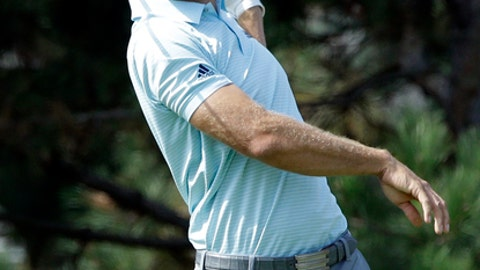 Dustin Johnson watches his tee shot on the fourth hole during the first round of the BMW Championship golf tournament at Conway Farms Golf Club, Thursday, Sept. 14, 2017, in Lake Forest, Ill. (AP Photo/Nam Y. Huh)