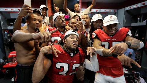 FILE - In this Jan. 22, 2017, file photo, Atlanta Falcons players celebrate in the locker room after the NFL football NFC championship game against the Green Bay Packers, in Atlanta. When the Falcons host the Packers on Sunday night, it will be both an early indicator of the NFC's balance of power as well as the third meeting between the teams in less than 11 months. All three of those games have been in Atlanta, though this one will be at a new venue. The Falcons (1-0) are making the regular-season debut at $1.5 billion Mercedes-Benz Stadium, which replaced the Georgia Dome. (AP Photo/David J. Phillip, File)