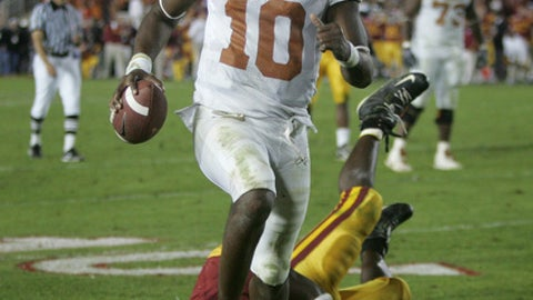 FILE - In this Jan. 4, 2006, file photo, Texas quarterback Vince Young rushes for the game-winning touchdown against Southern California during the Rose Bowl college football game in Pasadena, Calif. When Texas and Southern California last met on the football field, the Longhorns and Trojans put on a show many still call the greatest game in college football history. Texas (1-1) and No. 4 USC (2-0) meet again on Saturday night, Sept. 16, 2017. (AP Photo/Paul Sakuma, File)