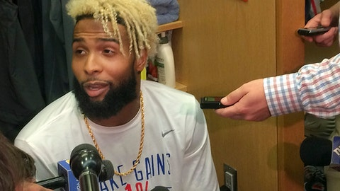 New York Giants wide receiver Odell Beckham Jr. speaks with reporters in the locker room at  NFL football team's training facility, Thursday, Sept. 14, 2017, in East Rutherford, N.J. Beckham, who has not practiced since spraining his ankle in a preseason game on Aug. 21, took the next step in his recovery from a sprained left ankle by participating in the individual segment of practice. (AP Photo/Tom Canavan)