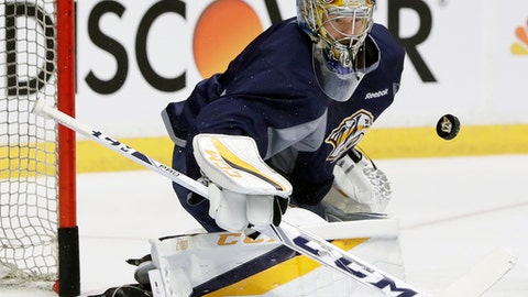 """FILE - In this June 2, 2017, file photo, Nashville Predators goalie Pekka Rinne, of Finland, blocks a shot during practice in Nashville, Tenn. The Nashville Predators couldn't be happier to return to work after their painful loss in the Stanley Cup Final and the shortest offseason in franchise history.""""I feel like it's been enough time,'' goaltender Pekka Rinne said Thursday, Sept. 14, 2017. (AP Photo/Mark Humphrey, File)"""
