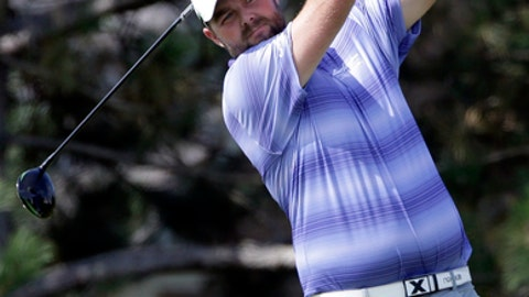 Marc Leishman watches his tee shot on the fourth hole during the first round of the BMW Championship golf tournament at Conway Farms Golf Club, Thursday, Sept. 14, 2017, in Lake Forest, Ill. (AP Photo/Nam Y. Huh)