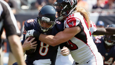 "FILE- In this Sept. 10, 2017, file photo, Chicago Bears quarterback Mike Glennon (8) gets sacked by Atlanta Falcons defensive end Brooks Reed (50) during the first half of an NFL football game in Chicago. Reed said Thursday, Sept. 14, that when Green Bay Packer's Aaron Rodgers starts moving around ""it's kind of like the play just started. It's the length of two plays. You've got to have your breath and be in good shape to be running around that much. It'll be important."" Atlanta takes on Green Bay on Sunday, Sept. 17. (AP Photo/Nam Y. Huh, File)"