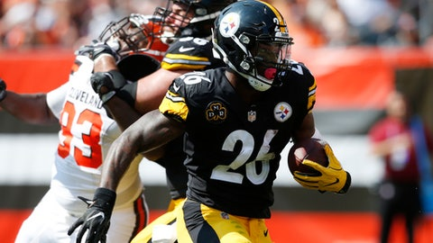 FILE - In this Sunday, Sept. 10, 2017 file photo, Pittsburgh Steelers running back Le'Veon Bell (26) runs with the ball during the second half of an NFL football game against the Cleveland Browns in Cleveland. Pittsburgh Steelers running back Le'Veon Bell is trying to stay upbeat after a slow start. Bell finished with just 47 total yards in a Week 1 victory over Cleveland, the lowest total for a game he's started and finished in his four-year career.(AP Photo/Ron Schwane, File)