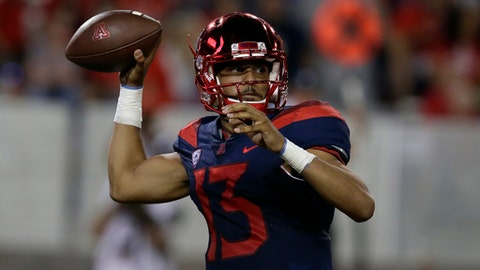In this Sept. 9, 2017, photo, Arizona quarterback Brandon Dawkins (13) in the first half during an NCAA college football game against Houston in Tucson, Ariz. Dawkins is expected to start at quarterback when Arizona visits UTEP a week after he was replaced in a loss to Houston with an explanation that seemed to fall somewhere between injury and ineffectiveness. (AP Photo/Rick Scuteri)