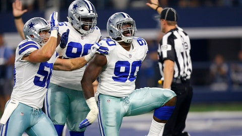 FILE - In this Sunday, Sept. 10, 2017 file photo, Dallas Cowboys' Sean Lee, left, Maliek Collins (96) and DeMarcus Lawrence (90) celebrate a sack by Lawrence during an NFL football game against the New York Giants in Arlington, Texas. Lawrence had two sacks as the Cowboys held a season-opening opponent to the fewest points in 22 years in a 19-3 win over the New York Giants. (AP Photo/Roger Steinman, File)