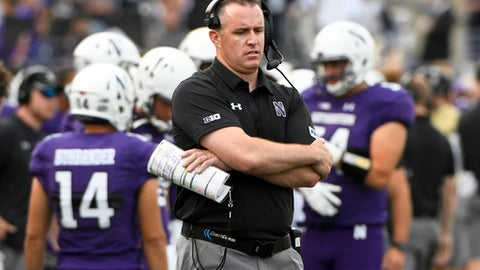 FILE - This Sept. 2, 2017, file photo shows Northwestern head coach Pat Fitzgerald looking on against Nevada during the second half of an NCAA college football game in Evanston, Ill. Just like last year, Northwestern is struggling in the early going. Don't think coach Pat Fitzgerald is buying the comparisons. The Wildcats come into the game, Saturday, Sept. 16, 2017 against Bowling Green trying to shake off a blowout loss and find their footing. (AP Photo/Matt Marton, File)