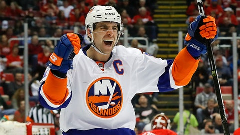 FILE - In this Feb. 21, 2017, file photo, New York Islanders center John Tavares (91) celebrates his goal against the Detroit Red Wings in the third period of an NHL hockey game, in Detroit. The New York Islanders got off to a slow start last season and, despite a strong second half that followed a midyear coaching change, finished a point out of a playoff spot. Captain John Tavares was looking forward to a full training camp after missing out last year while helping Canada win the World Cup of Hockey. (AP Photo/Paul Sancya, File)