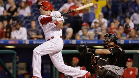 Philadelphia Phillies' Rhys Hoskins follows through on a two-run home run off Miami Marlins starting pitcher Vance Worley during the second inning of a baseball game, Thursday, Sept. 14, 2017, in Philadelphia. At right is catcher J.T. Realmuto. (AP Photo/Matt Slocum)