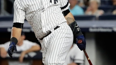 New York Yankees' Gary Sanchez follows through on an RBI double during the first inning of a baseball game against the Baltimore Orioles on Thursday, Sept. 14, 2017, in New York. (AP Photo/Frank Franklin II)