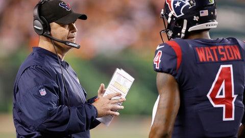 Houston Texans coach Bill O'Brien, left, speaks with quarterback Deshaun Watson (4) during the first half of an NFL football game against the Cincinnati Bengals, Thursday, Sept. 14, 2017, in Cincinnati. (AP Photo/Gary Landers)