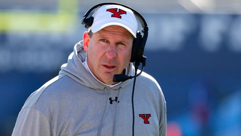 Youngstown State head coach Bo Pelini walks along the sideline in the second half of the FCS championship NCAA college football game against James Madison on Saturday, Jan. 7, 2017, in Frisco, Texas. (AP Photo/Tony Gutierrez)
