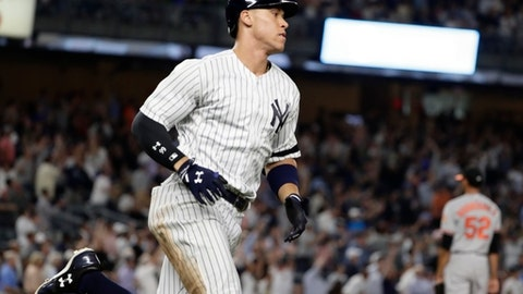 New York Yankees' Aaron Judge passes Baltimore Orioles relief pitcher Richard Rodriguez as he runs the bases after hitting three-run home run during the sixth inning of a baseball game Thursday, Sept. 14, 2017, in New York. (AP Photo/Frank Franklin II)