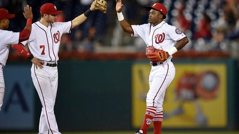 Washington Nationals' Victor Robles, right, celebrates with Trea Turner (7) after a baseball game against the Atlanta Braves, Thursday, Sept. 14, 2017, in Washington. The Nationals won 5-2. (AP Photo/Nick Wass)