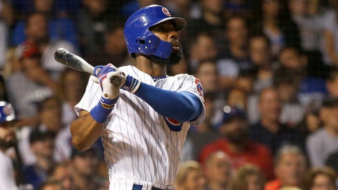 Chicago Cubs' Jason Heyward watches his three-run home run off New York Mets' Paul Sewald, also scoring Javier Baez and Albert Almora Jr., during the sixth inning of a baseball game Thursday, Sept. 14, 2017, in Chicago. (AP Photo/Charles Rex Arbogast)