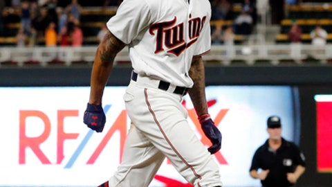 Minnesota Twins' Byron Buxton heads for home on his solo walkoff home run off Toronto Blue Jays pitcher Luis Santos during the 10th inning of a baseball game Thursday, Sept. 14, 2017, in Minneapolis. The Twins won 3-2. (AP Photo/Jim Mone)