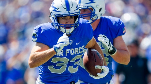 FILE - In this Sept. 2, 2017, file photo, Air Force running back Tim McVey runs for a touchdown against VMI during an NCAA college football game in Air Force Academy, Colo., Saturday, Sept. 2, 2017. Air Force, which has won seven straight, plays Michigan this week. (Dougal Brownlie/The Gazette via AP, File)