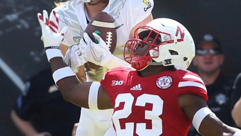FILE - In this Sept. 9, 2017, file photo, Oregon wide receiver Brenden Schooler pulls down a touchdown reception against Nebraska defensive back Dicaprio Bootle during the first quarter of an NCAA college football game in Eugene, Ore.  Bootle is confident better days are ahead for the Nebraska defense.  the Cornhuskers (1-1) believe they have something to build on when Northern Illinois plays at Nebraska on Saturday. (AP Photo/Chris Pietsch, File)