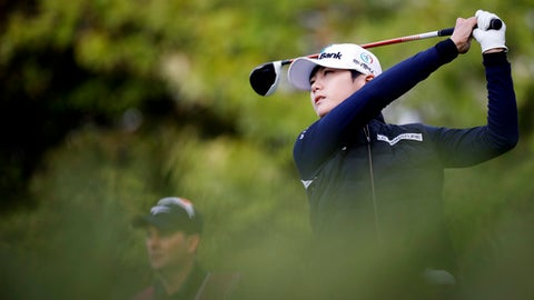 Sung Hyun Park, of South Korea, follows her ball after playing on the 11th hole during the first round of the Evian Championship women's golf tournament in Evian, eastern France, Friday, Sept. 15, 2017. (AP Photo/Laurent Cipriani)