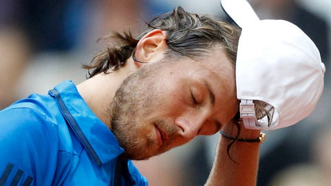 France's Lucas Pouille reacts to Dusan Lajovic of Serbia during their Davis Cup semi final at the Pierre Mauroy stadium in Lille, northern France, Friday, Sept.15, 2017. (AP Photo/Michel Spingler)